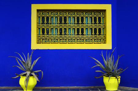 laurent: Marrakesh, Morocco - November 24th 2014: Colorful flower pot and window in Jardin Majorelle, former residence of fashion designer Yves Saint Laurent, now open for public