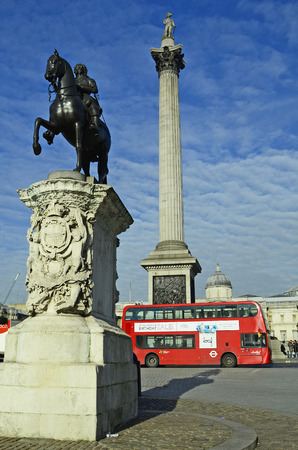 nelson: London, United Kingdom - January 19th 2016: Traditional double-decker bus and Nelson column on Trafalgar square,