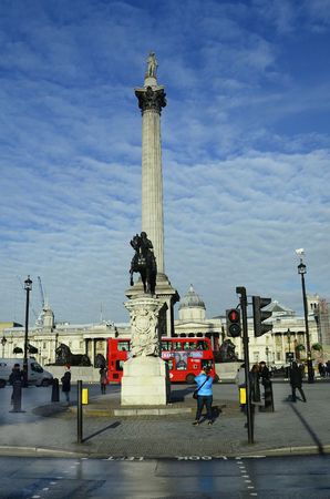 nelson: London, United Kingdom - January 19th 2016: Unidentified people, Nelson Column and National Gallery on Trafalgar square,