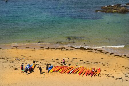 st  malo: Saint Malo, France - June 7th 2011: Unidentified people on beach with canoes Editorial