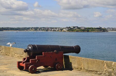 st  malo: France, medieval cannon on the St. Malo town wall with view to Dinard Village