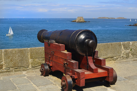 du: medieval cannon on St. Malo town wall with view to Fort Du Petit-Be