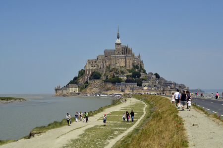 or san michele: Mont San Michel, France - June 4th 2011: Unidentified people and Unesco World Heritage site Mont San Michele abbey Editorial