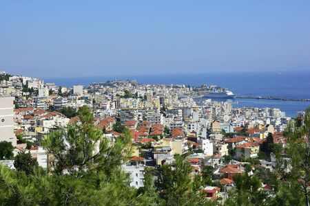 cruising: Greece, cityscape of Kavala with fortress, harbor and cruising ship