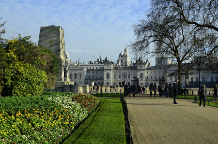 division: London, United Kingdom - January 19th 2016: Unidentified people in St. James park with building of horse guards parade and Guards Division memorial Editorial
