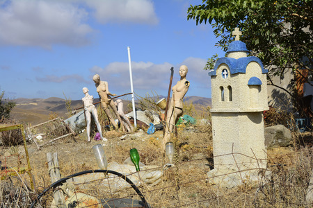 wayside: Greece, crap space with demaged window mannequins and wayside shrine