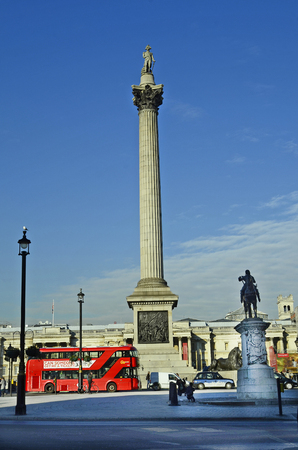 nelson: London, United Kingdom - January 19th 2016: Unidentified people and traffic on Trafalgar square with Nelson column and Prince Albert memorial