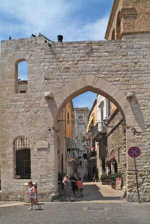 archways: Bari, Italy - June 13th 2007: Unidentified people and archway to narrow street of the old part of the city in Puglia