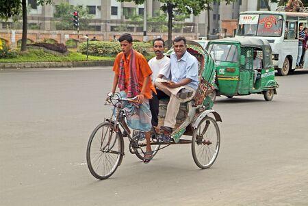 rikscha: Dhaka, Bangladesh - Setember 17th 2007: Unidentified people on rickshaw, tuk-tuk and bus an usual mode of transport in the capital