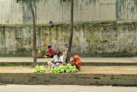 poorness: Dhaka, Bangladesh - Setember 17th 2007: Unidentified people sell fruits on street, traditional kind of sale by poor peasants