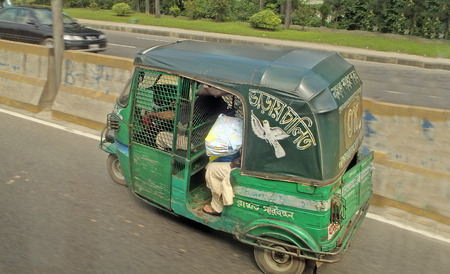 mode transport: Dhaka, Bangladesh - Setember 17th 2007: Motorized rickshaw named Tuk-Tuk, usual mode of transport in the capital