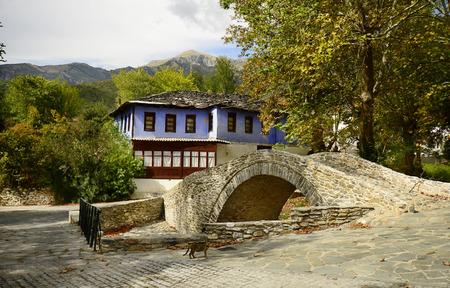 pedestrian bridge: Greece, stone built pedestrian bridge and colorful home in the mountain village Moustheni