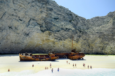 ionian island: Zakynthos, Greece - May 25th 2016: Unidentified people on shipwreck beach, landmark and preferred tourist attraction on the Ionian island
