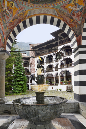 portico: Rila, Bulgaria - frescoes and fountain in the portico of Unesco Wordl Heritage site Monastery of Saint Ivan of Rila - named Rila monastery. Kloster des Heiligen Iwan Rilski