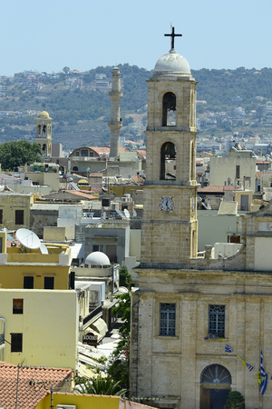 minaret: Greece, Crete, church and minaret in Chania Stock Photo