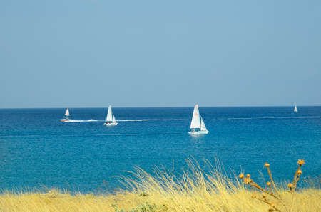 aegean: Myrina, Lemnos - September 21st 2015: Unidentified people in sailing boats in aegean sea