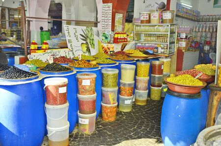 souk: Casablanca, Morocco - November 18th 2014: Shop with different goods, olives, fruits and vegetablein the souk of the city