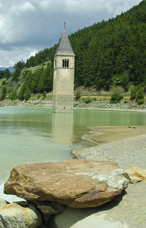 church tower: Italy, sunken church tower in Reschen Lake - Lago di Resia - in South Tyrol Stock Photo