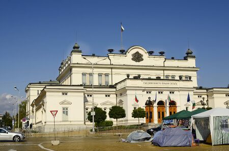 parliament building: Sofia, Bulgaria - parliament building and tents from protest meeting against government Editorial