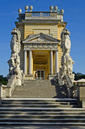 gloriette: Vienna, Austria - stairway with stone sculptures to side entrance of the Gloriette building, former part of the Habsburg monarchy garden of Schoenbrunn, now a Cafe and viewing point over Vienna Stock Photo