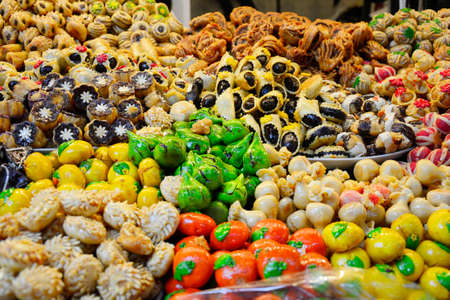 suq: Morocco, shop with different sweets in the souk of Marrakesh