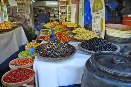 general store: Casablanca, Morocco - November 18th 2014: Shop with different goods, olives, fruits and vegetable in the souk of the city