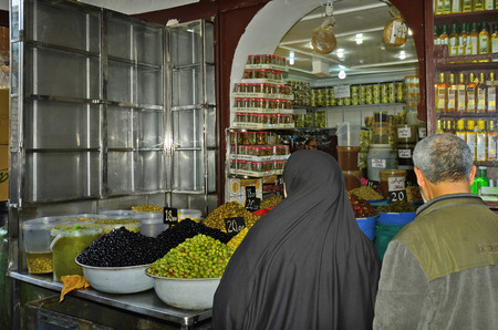 general store: Casablanca, Morocco - November 18th 2014: Unidentified people in grocery specialiced for olives in the souk of the city