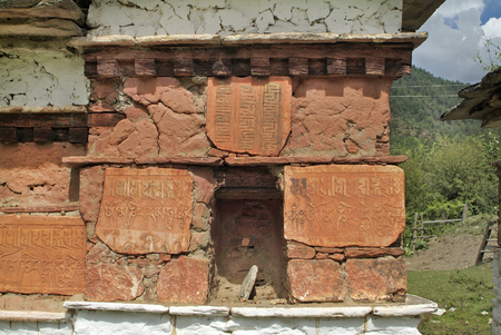 mani: Bhutan, Mani wall with symbols in Paro valley Stock Photo