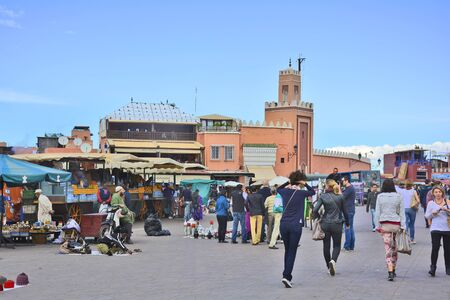 street vendor: Marrakesh, Morocco - November 22nd 2014: Unidentified people, kiosks and street vendor on Djemaa el-Fna, tourist attraction and Unesco World Heritage site Editorial