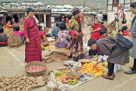 Wangdue, Bhutan - September 24th 2007: Unidentified people on the weekly farmers market in the district capital