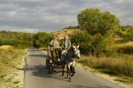 horse cart: Bulgaria, friendly looking couple of peasants on traditional horse cart in Rila valley Editorial