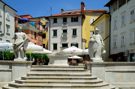 pictoresque: Piran, Slovenia - July 4th 2015: Square with sculptures, restaurant and buildings  in the pictoresque village on Adriatic sea