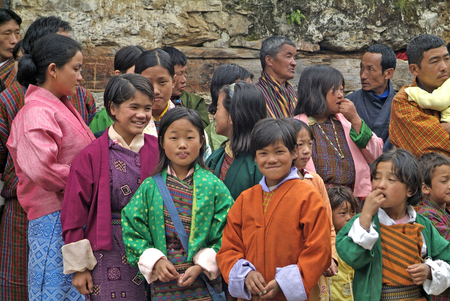 Jakar, Bhutan - September 26th 2007: Unidentified people in tradtional clothing by fire and smoke ceremony in Thangbi Temple
