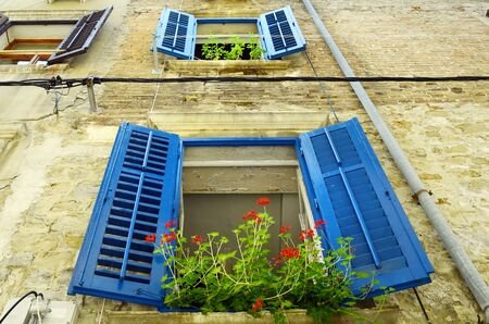 Slovenia, Piran, home with colorful window shutters in the pictoresque village on Adriatic sea