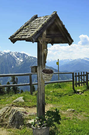 Austria, Tirol, statue of Christ in Tyrolean mountains Stock Photo