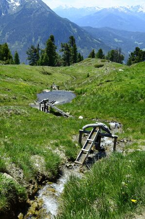 watermills: Austria, Tirol, wooden watermills and mountain spring on Hochzeiger mountain