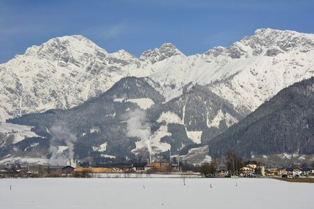 winterly: Austria, winterly landscape with timber mill and Leoganger Steinberge in background