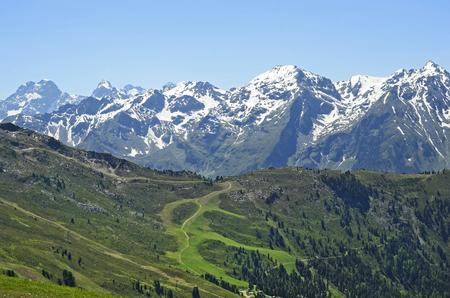 tirol: Austria, Tirol, snowy Austrian alps and trail through alpine pasture
