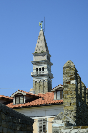 george: Slovenia, Piran, bell tower of Saint George cathedral in the picturesque village on Adriatic sea