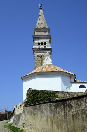 Slovenia, Piran, chapel of John the Baptist and bell tower in the picturesque village on Adriatic sea Stock Photo