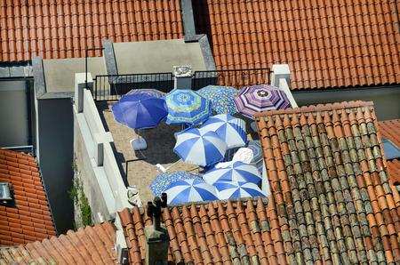 sun roof: Slovenia, Piran, roof garden with colorful sun umbrellas in the picturesque village on Adriatic sea Stock Photo
