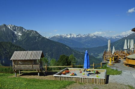 sandpit: Austria, Tirol, view from terrace with sandpit over Pitztal and Tyrolean alps