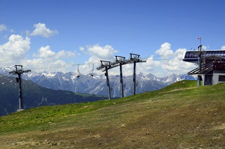 landscape mode: Austria, Tirol, upper terminus from chairlift Hochzeiger mountain with Austrian alps