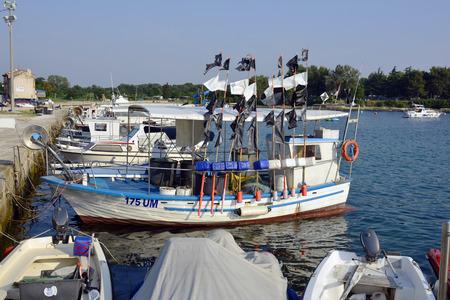 harbors: Savudria, Croatia - July 5th 2015: Fishing boats in the harbors of the tiny village on adriatic sea