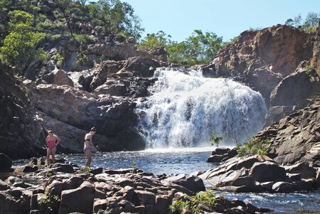 edith: Katherine, Australia - April 23rd 2010: Unidentified people enjoy bathing in natural pool of Edith Falls aka Leliyn Falls in Nitmiluk nationalpark, Northern Territory