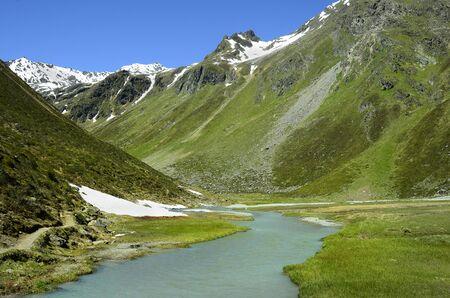 tirol: Austria, Tirol, creek made from melting snow in Austrian Alps Stock Photo