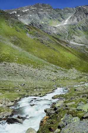 tirol: Austria, Tirol, creek from melting snow in Austrian alps,