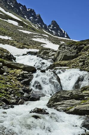 snowfield: Austria, Tirol, snowfield and creek from melting snow in Austrian alps