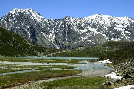 tirol: Austria, Tirol, Rifflsee lake and snow remains in Austrian Alps in Pitztal
