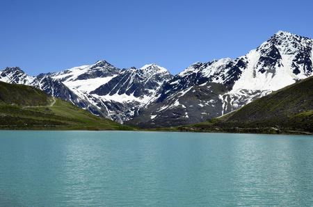 tirol: Austria, Tirol, Rifflsee lake and Austrian Alps in Pitztal Stock Photo
